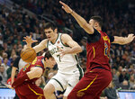 Milwaukee Bucks' Ersan Ilyasova (7) loses the ball against Cleveland Cavaliers' Larry Nance Jr., right, during the first half of an NBA basketball game Monday, Oct. 28, 2019, in Milwaukee. (AP Photo/Jeffrey Phelps)