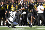CORRECTS TO UPON REVIEW HE DID NOT SCORE-Missouri running back Tyler Badie (1) runs past Vanderbilt safety Dashaun Jerkins (33) during the first half of an NCAA college football game Saturday, Nov. 28, 2020, in Columbia, Mo. (AP Photo/L.G. Patterson)