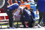 New York Giants running back Saquon Barkley is attended to on the bench by medical staff after being injured against the Chicago Bears during the first half of an NFL football game in Chicago, Sunday, Sept. 20, 2020. (AP Photo/Nam Y. Huh)
