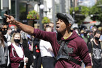 Demonstrator Demetrius Harris talks to the crowd as a protest begins Monday, June 1, 2020, in Seattle, following protests over the weekend over the death of George Floyd, a black man who died after being restrained by Minneapolis police officers on May 25. (AP Photo/Elaine Thompson)