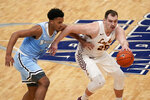 Loyola of Chicago's Cameron Krutwig, right, dribbles as Indiana State's Tre Williams defends during the second half of an NCAA college basketball game in the semifinal round of the Missouri Valley Conference men's tournament Saturday, March 6, 2021, in St. Louis. (AP Photo/Jeff Roberson)