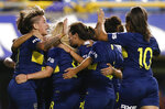 Boca Juniors' Noelia Espindola, not seen, celebrates scoring against Lanus with teammates during the Superliga women's tournament in Buenos Aires, Argentina, Saturday, March 9, 2019. The women competed in one of Argentina's most famous stadiums on Saturday, a milestone for the female players who are fighting for the same rights as male soccer players in the country's most popular sport. (AP Photo/Natacha Pisarenko)