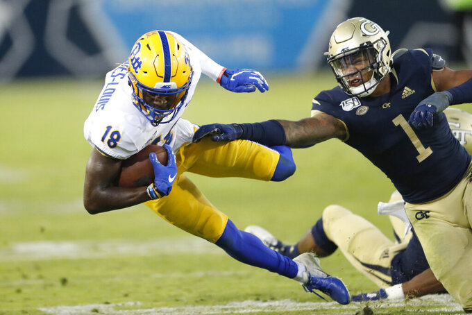 Pittsburgh wide receiver Shocky Jacques-Louis (18) is brought down by Georgia Tech defensive back Juanyeh Thomas (1) in the second half of an NCAA college football game Saturday, Nov. 2, 2019, in Atlanta. (AP Photo/John Bazemore)