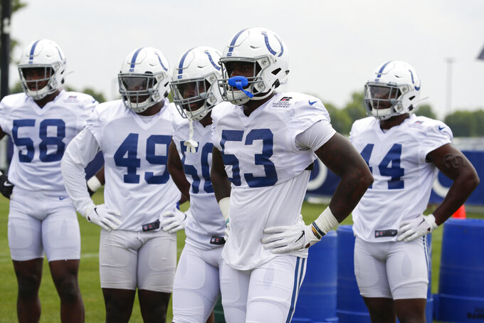 Indianapolis Colts outside linebacker Darius Leonard (53) leads a group of defensive players as they run a drill during practice at the NFL team's football training camp in Westfield, Ind., Friday, July 26, 2019. (AP Photo/Michael Conroy)