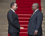 South African President Cyril Ramaphosa, right, welcomes Ethiopia's Prime Minister Abiy Ahmed prior to their talks at the Union Building in Pretoria, South Africa, Sunday, Jan. 12, 2020. (AP Photo/Themba Hadebe)