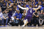 FILE - In this Nov. 26, 2019, file photo, Stephen F. Austin forward Nathan Bain (23) and guard David Kachelries (4) celebrate Bain's game-winning basket against Duke in overtime of an NCAA college basketball game in Durham, N.C. (AP Photo/Gerry Broome, File)
