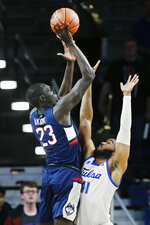 Connecticut forward Akok Akok (23) shoots over Tulsa forward Jeriah Horne (41) during the second half of an NCAA college basketball game in Tulsa, Okla., Thursday, Feb. 6, 2020. (AP Photo/Sue Ogrocki)