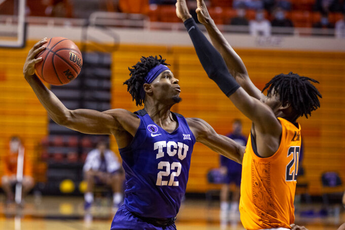 Oklahoma State's Keylan Boone (20) guards Texas Christian guard RJ Nembhard (22) during the first half of the NCAA college basketball game in Stillwater, Okla., Wednesday, Dec. 16, 2020. (AP Photo/Mitch Alcala)