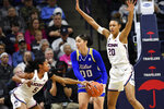 Connecticut's Crystal Dangerfield (5) attempts a steal from Tulsa's Kendrian Elliott (00) during the first half of an NCAA college basketball game Sunday, Jan. 19, 2020, in Storrs, Conn. (AP Photo/Stephen Dunn)
