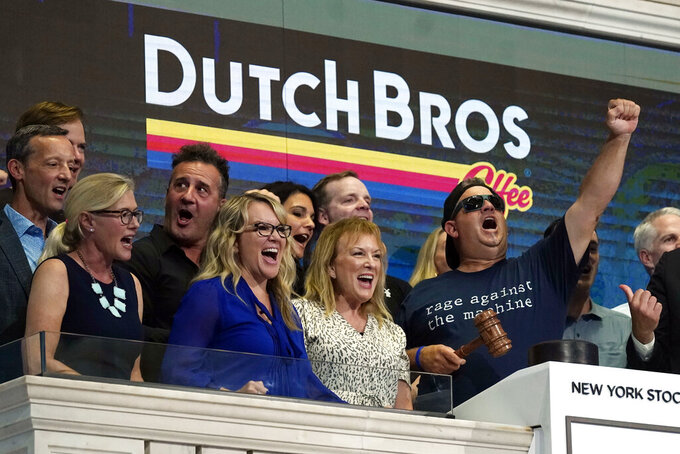 Dutch Bros Coffee Co-founder and Executive Chairman Travis Boersma, right, leads a chant before ringing the New York Stock Exchange closing bell, Wednesday, Sept. 15, 2021. (AP Photo/Richard Drew)