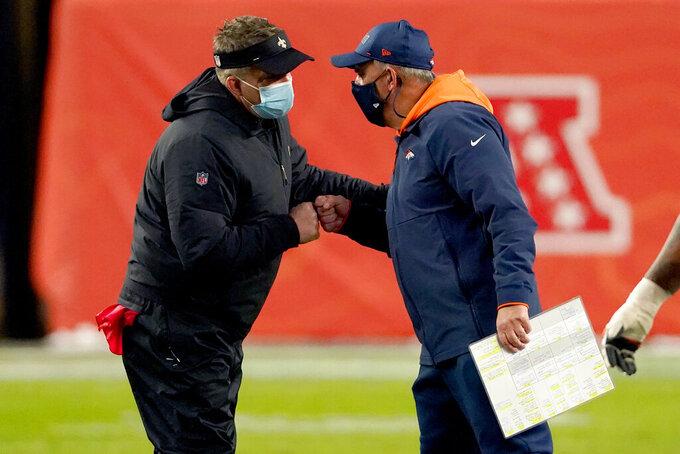 New Orleans Saints head coach Sean Payton, left, greets Denver Broncos head coach Vic Fangio after an NFL football game, Sunday, Nov. 29, 2020, in Denver. The Saints won 31-3. (AP Photo/Jack Dempsey)