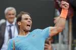 Rafael Nadal of Spain celebrates after defeating Stefanos Tsitsipas of Greece during a semifinal match at the Italian Open tennis tournament, in Rome, Saturday, May 18, 2019. Nadal won 6-3, 6-4. (AP Photo/Andrew Medichini)