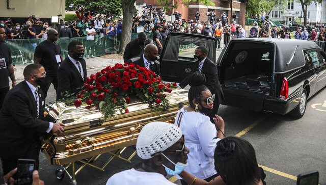 CORRECTS TO MEMORIAL SERVICE, NOT FUNERAL - George Floyd's casket carried to a hearse after a memorial service for Floyd at North Central University, Thursday, June 4, 2020, in Minneapolis. Floyd died after being restrained by Minneapolis police officers on May 25. (AP Photo/Bebeto Matthews)