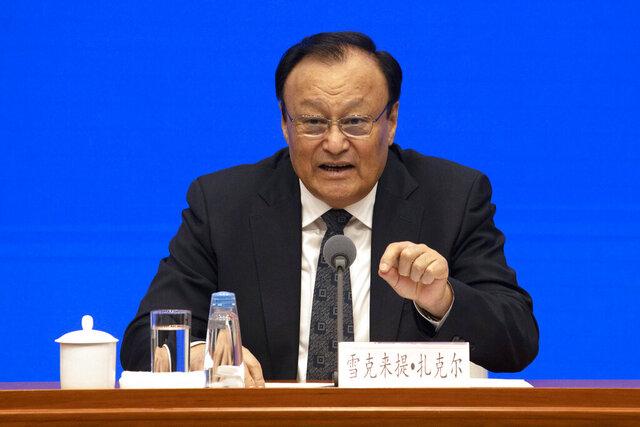 Shohrat Zakir, chairman of China's Xinjiang Uighur Autonomous Region speaks during a press conference in Beijing Monday, Dec. 9, 2019. (AP Photo/Ng Han Guan)