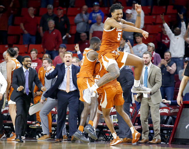 Texas' Royce Hamm Jr. (5) celebrates the team's win over Oklahoma in an NCAA college basketball game in Norman, Okla., Tuesday, March 3, 2020. (Sarah Phipps/The Oklahoman via AP)