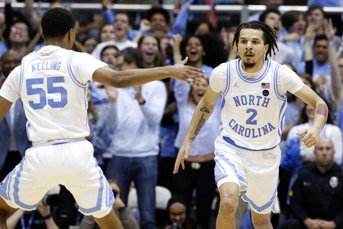 North Carolina guard Christian Keeling (55) and guard Cole Anthony (2) react following a play against North Carolina State during the second half of an NCAA college basketball game in Chapel Hill, N.C., Tuesday, Feb. 25, 2020. (AP Photo/Gerry Broome)