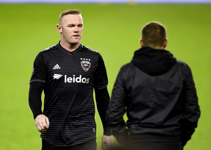 D.C. United forward Wayne Rooney walks off the pitch for the last time in his MLS career, an MLS Eastern Conference first-round playoff soccer match against Toronto FC in Toronto on Saturday, Oct. 19, 2019. (Frank Gunn/The Canadian Press via AP)