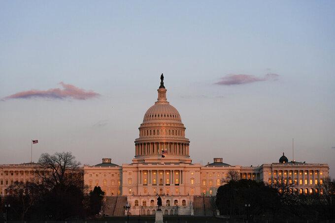 The sun sets on the U.S. Capitol building, Thursday, March 4, 2021, in Washington. (AP Photo/Alex Brandon)