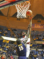 West Virginia's Derek Culver(1) is defended by Northern Colorado's Kur Jockuch (15) as he goes to make a shot during the second half of an NCAA college basketball game Monday Nov. 18, 2019, Morgantown, W.Va. (AP Photo/Kathleen Batten)