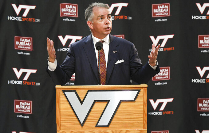 New Virginia Tech men's NCAA college basketball head coach Mike Young speaks at an introductory press conference in Blacksburg, Va., Monday, April 8, 2019. (Michael Shroyer/The Roanoke Times via AP)