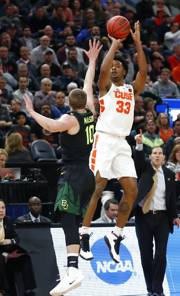Syracuse forward Elijah Hughes (33) shoots as Baylor guard Makai Mason (10) defends during the first half of a first-round game in the NCAA men's college basketball tournament Thursday, March 21, 2019, in Salt Lake City. (AP Photo/Rick Bowmer)