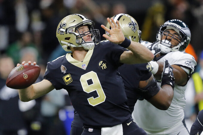 New Orleans Saints quarterback Drew Brees (9) throws an interception on the first play from scrimmage in the first half of an NFL divisional playoff football game against the Philadelphia Eagles, in New Orleans, Sunday, Jan. 13, 2019. (AP Photo/Gerald Herbert)