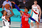 Philadelphia 76ers' Matisse Thybulle (22)  defends against Portland Trail Blazers' Damian Lillard during the third quarter of an NBA basketball game Sunday, Aug. 9, 2020, in Lake Buena Vista, Fla. (Kevin C. Cox/Pool Photo via AP)