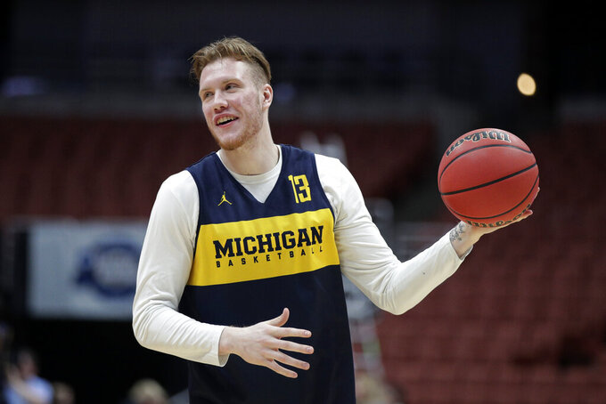 Michigan's Ignas Brazdeikis smiles while running through a drill during practice at the NCAA men's college basketball tournament in Anaheim, Calif., Wednesday, March 27, 2019. Michigan plays Texas Tech in a West Regional semifinal on Thursday. (AP Photo/Jae C. Hong)