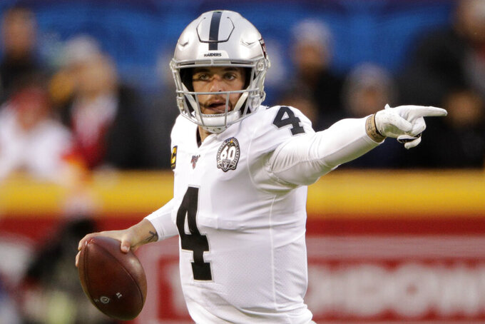 Oakland Raiders quarterback Derek Carr (4) gestures during the first half of an NFL football game against the Kansas City Chiefs in Kansas City, Mo., Sunday, Dec. 1, 2019. (AP Photo/Charlie Riedel)