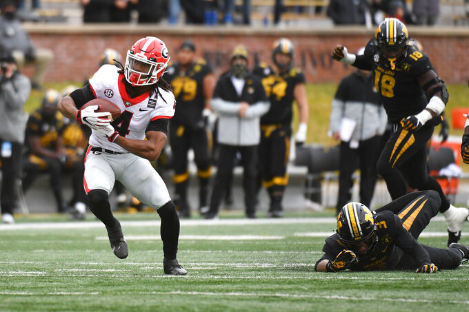 Georgia running back James Cook catches a 37-yard pass for a touchdown during the first half of an NCAA college football game against Missouri Saturday, Dec. 12, 2020, in Columbia, Mo. (AP Photo/L.G. Patterson)