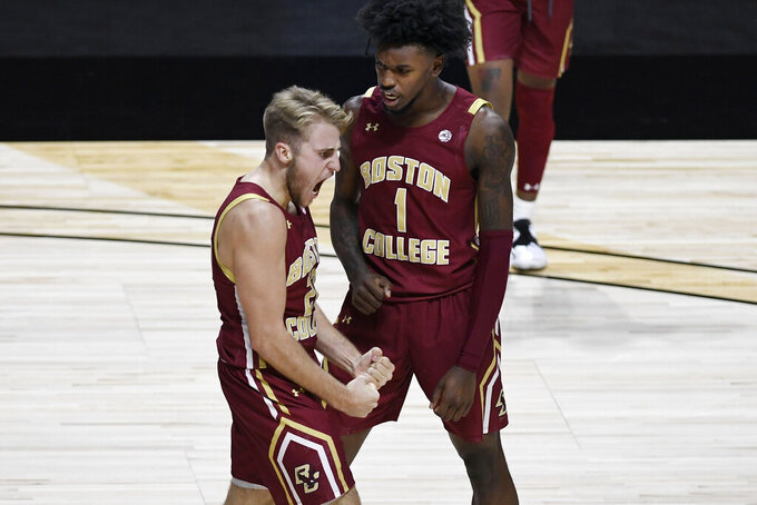 Boston College's Rich Kelly, left, and CJ Felder, right, react during the second half of the team's NCAA college basketball game against Rhode Island, Thursday, Nov. 26, 2020, in Uncasville, Conn. (AP Photo/Jessica Hill)