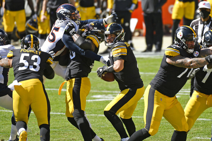 Pittsburgh Steelers quarterback Ben Roethlisberger (7) looks to pass during the first half of an NFL football game against the Denver Broncos in Pittsburgh, Sunday, Sept. 20, 2020. (AP Photo/Don Wright)
