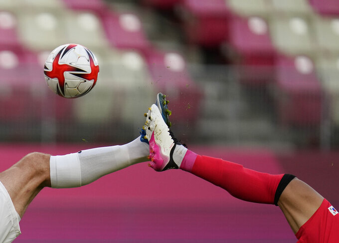 South Korea's Won Dujae, right, and New Zealand's Chris Wood battle for the ball during a men's soccer match at the 2020 Summer Olympics, Thursday, July 22, 2021, in Kashima, Japan. (AP Photo/Fernando Vergara)