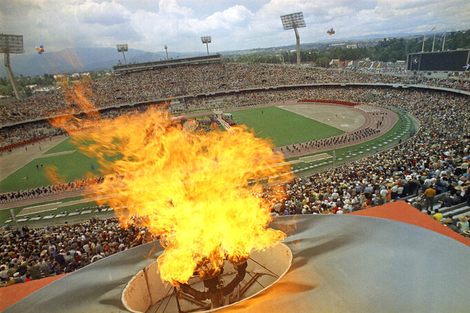 The Olympic Torch burns during the opening day ceremony in Mexico City, Oct. 12, 1968. (AP Photo)