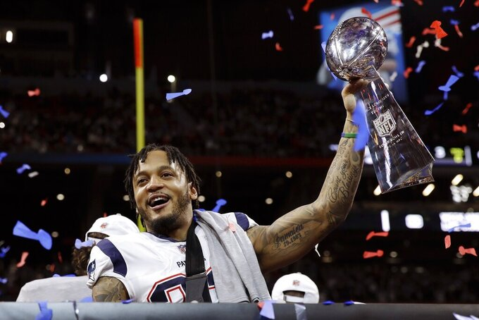 New England Patriots' Patrick Chung lifts the trophy after the NFL Super Bowl 53 football game against the Los Angeles Rams, Sunday, Feb. 3, 2019, in Atlanta. The Patriots won 13-3. (AP Photo/Carolyn Kaster)