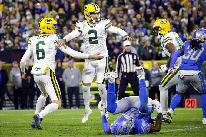 Green Bay Packers kicker Mason Crosby (2) celebrates scoring the winning field goal with punter J.K. Scott (6) during the second half of an NFL football game  against the Detroit Lions, Monday, Oct. 14, 2019, in Green Bay, Wis. (AP Photo/Jeffrey Phelps)