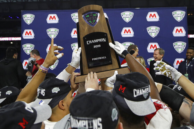 d FILE - In this Dec. 7, 2019, file photo, members of the Miami of Ohio team hold the champion trophy after the Mid-American Conference championship NCAA college football game against Central Michigan in Detroit. The Mid-American Conference announced Friday, Sept. 25, 2020, that it will have a 6-game football season, meaning all 10 major conferences will play this fall. (AP Photo/Carlos Osorio, File)