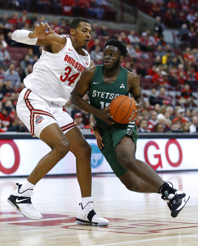 Stetson's Kenny Aninye, right, drives to the basket as Ohio State's Kaleb Wesson defends during the first half of an NCAA college basketball game Monday, Nov. 18, 2019, in Columbus, Ohio. (AP Photo/Jay LaPrete)