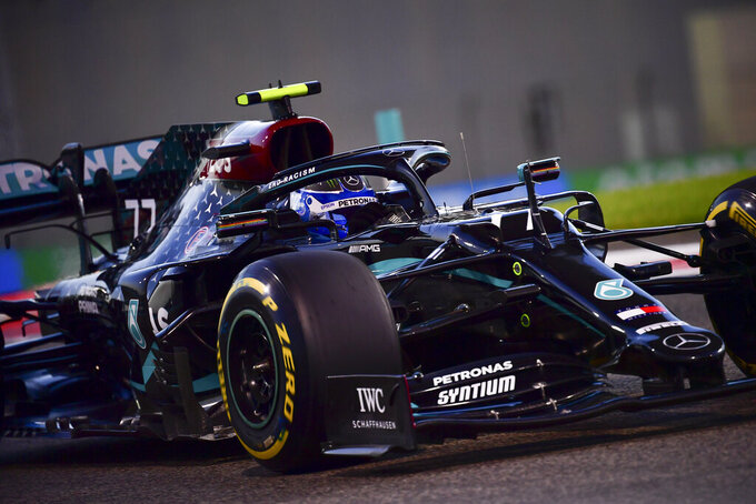 Mercedes driver Valtteri Bottas of Finland in action during second practice at the Formula One Abu Dhabi Grand Prix in Abu Dhabi, United Arab Emirates, Friday, Dec, 10, 2020. (Giuseppe Cacace, Pool via AP)