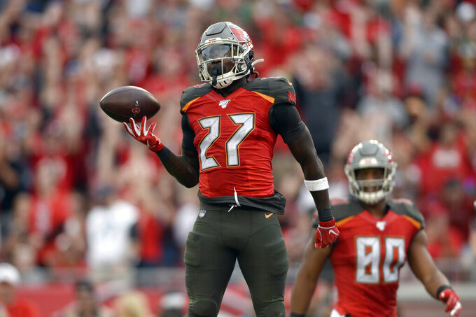 Tampa Bay Buccaneers running back Ronald Jones II (27) celebrates his 4-yard score against the Houston Texans during the first half of an NFL football game Saturday, Dec. 21, 2019, in Tampa, Fla. (AP Photo/Jason Behnken)