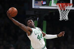 Boston Celtics center Robert Williams III (44) reaches for a rebound during the first half of an NBA basketball game against the Miami Heat in Boston, Wednesday, Dec. 4, 2019. (AP Photo/Charles Krupa)
