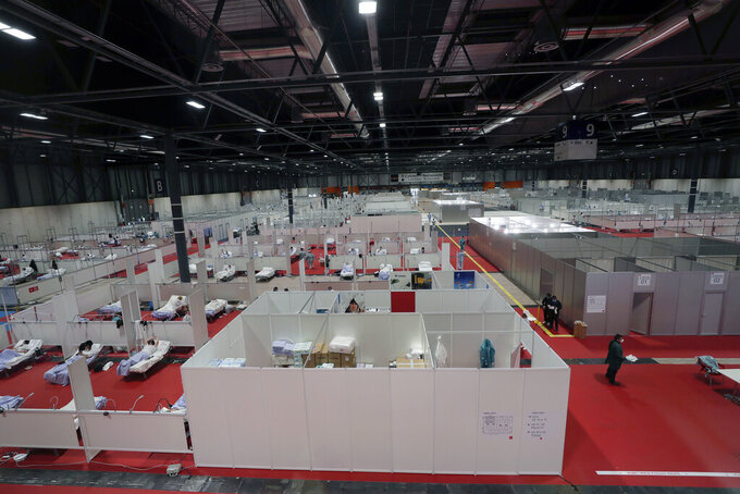 A general view a temporary field hospital set at Ifema convention and exhibition of in Madrid, Spain, Thursday, April 2, 2020. The new coronavirus causes mild or moderate symptoms for most people, but for some, especially older adults and people with existing health problems, it can cause more severe illness or death. (AP Photo/Manu Fernandez)