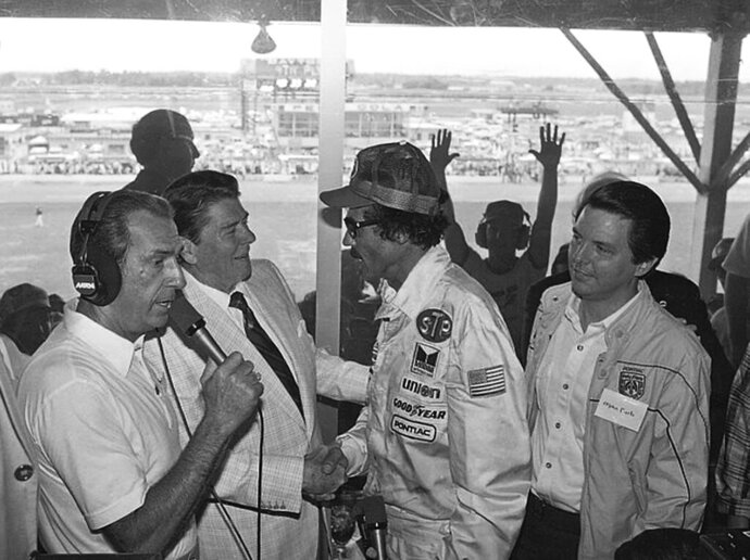 FILE - In this July 4, 1984, file photo, President Ronald Reagan congratulates stock car driver Richard Petty, who won the Firecracker 400 race at the Daytona International Speedway in Daytona Beach, Fla. President Donald Trump will look to rev up his appeal with a key voting demographic Sunday — NASCAR fans — as he takes in the Daytona 500. (AP Photo/Ira Schwarz, File)