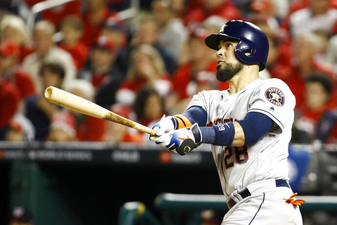 Houston Astros' Robinson Chirinos watches his two-run home run during the fourth inning of Game 4 of the baseball World Series against the Washington Nationals Saturday, Oct. 26, 2019, in Washington. (AP Photo/Patrick Semansky)