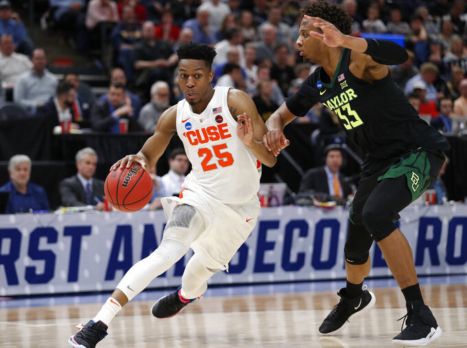 Syracuse guard Tyus Battle (25) drives as Baylor forward Freddie Gillespie (33) defends during the second half of a first-round game in the NCAA men's college basketball tournament Thursday, March 21, 2019, in Salt Lake City. (AP Photo/Jeff Swinger)