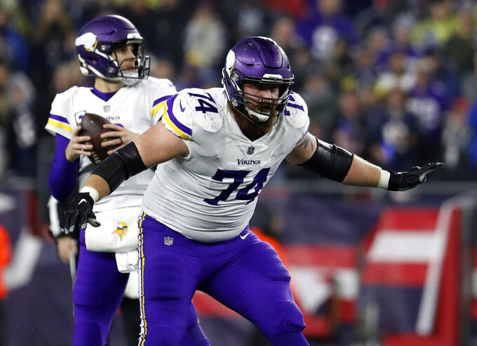 FILE - In this Dec. 2, 2018, file photo, Minnesota Vikings offensive tackle Mike Remmers blocks during an NFL football game against the New England Patriots at Gillette Stadium in Foxborough, Mass. The New York Giants signed the free agent offensive tackle on Tuesday, May 14, 2019. (Winslow Townson/AP Images for Panini, via AP, File)