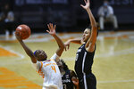 Tennessee's Jordan Walker (4) shoots while defended by Connecticut's Olivia Nelson-Ododa (20) during an NCAA college basketball game in Knoxville, Tenn., Thursday, Jan. 21, 2021. (Saul Young/Knoxville News Sentinel via AP, Pool)