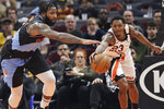 Cleveland Cavaliers' Andre Drummond, left, and Los Angeles Clippers' Lou Williams battle for loose ball in the second half of an NBA basketball game, Sunday, Feb. 9, 2020, in Cleveland. The Clippers won 133-92. (AP Photo/Tony Dejak)