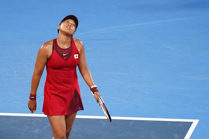 Naomi Osaka, of Japan, reacts during a third round women's tennis match against Marketa Vondrousova, of the Czech Republic, at the 2020 Summer Olympics, Tuesday, July 27, 2021, in Tokyo, Japan. (AP Photo/Patrick Semansky)