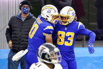 Los Angeles Chargers wide receiver Tyron Johnson (83) celebrates with Justin Herbert (10) after catch a touchdown pass during the second half of an NFL football game against the Atlanta Falcons Sunday, Dec. 13, 2020, in Inglewood, Calif. (AP Photo/Jae C. Hong)